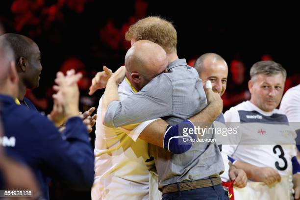 Prince Harry congratulates the Georgian Team as at the Sitting Volleyball Finals during the Invictus Games 2017 at Mattamy Athletic Centre on...