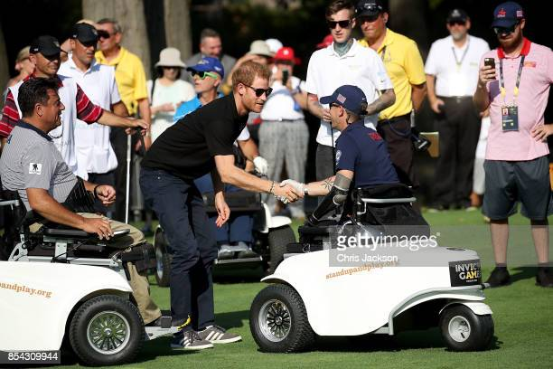 Prince Harry congratulates the teams at the Golf during the Invictus Games 2017 at St George's Golf Club on September 26 2017 in Toronto Canada