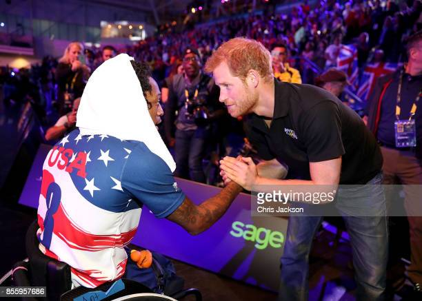 Prince Harry congratulates the US team at the Wheelchair Basketball Finals during the Invictus Games 2017 at Mattamy Athletic Centre on September 30...