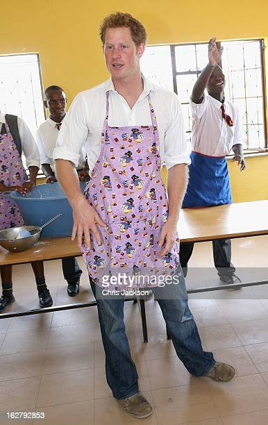 Prince Harry cooks cakes as he visits Kananelo Centre for the deaf, a project supported by his charity Sentebale on February 27, 2013 in Maseru,...