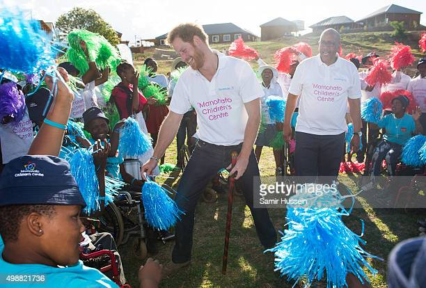 Prince Harry dances with children at the opening of Sentebale's Mamohato Children's Centre during an official visit to Africa on November 26 2015 in...
