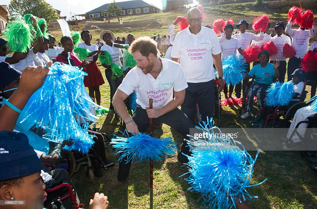 Prince Harry dances with children at the opening of Sentebale's Mamohato Children's Centre during an official visit to Africa on November 26, 2015 in Maseru, Lesotho.
