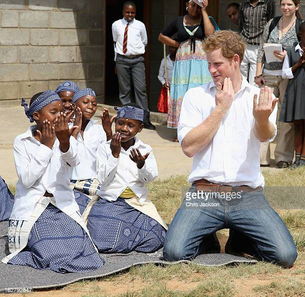 Prince Harry dances with deaf children during at visit to the Kananelo Centre for the deaf a project supported by his charity Sentebale on February...
