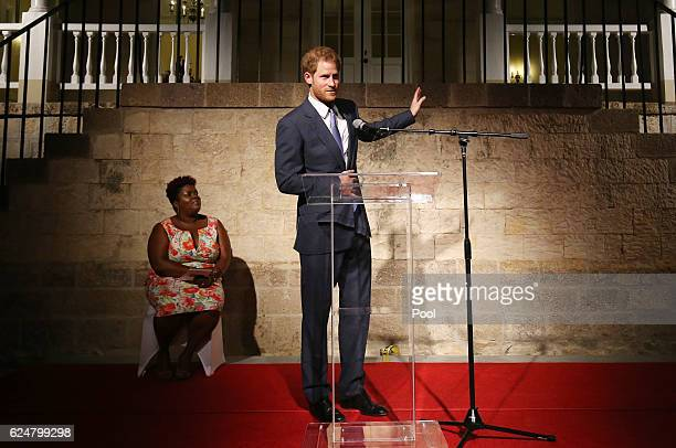 Prince Harry delivers a speech during a welcome reception hosted by the Governor General Sir Rodney Williams at the newly renovated Clarence House on...