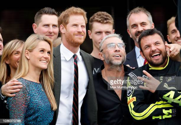 Prince Harry Duke of Sussex accompanied by James Holder and Paul Vice visits The Royal Marines Commando Training Centre on September 13 2018 in...
