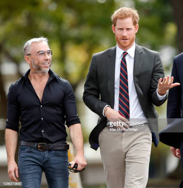Prince Harry Duke of Sussex accompanied by James Holder visits The Royal Marines Commando Training Centre on September 13 2018 in Lympstone England...