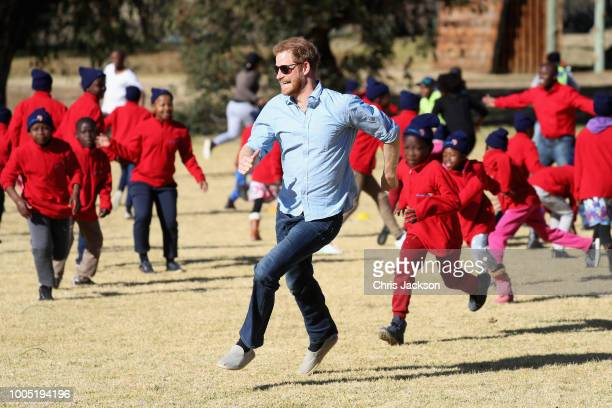 Prince Harry Duke of Sussex and children run during Winter Camp at Sentebale's Mamohato Children's Centre on June 22 2018 near Maseru Lesotho The...