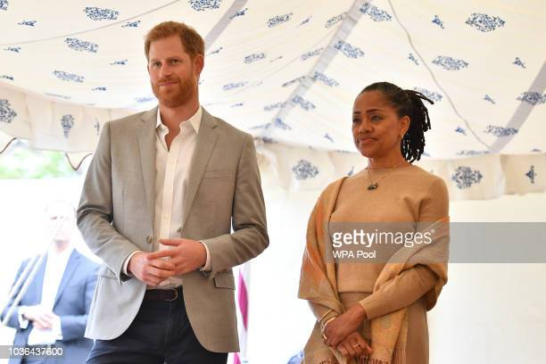 Prince Harry Duke of Sussex and Doria Ragland listen to Meghan Duchess of Sussex speaking at an event to mark the launch of a cookbook with recipes...
