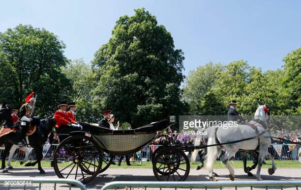 Prince Harry Duke of Sussex and Duchess of Sussex in the Ascot Landau carriage during the procession on The Long Walk after getting married St...