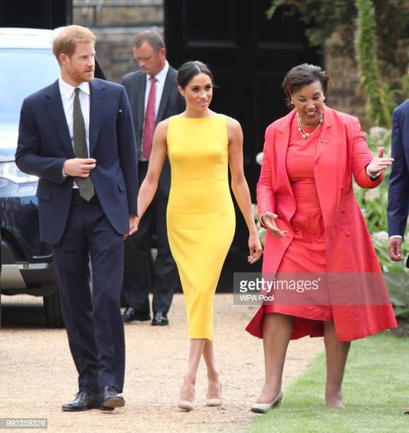 Prince Harry Duke of Sussex and Meghan Duchess of Sussex accompanied by Commonwealth secretary general Baroness Scotland arrive to attend the Your...