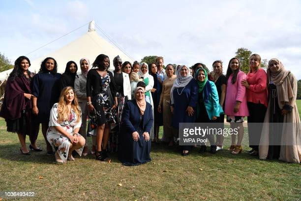 Prince Harry Duke of Sussex and Meghan Duchess of Sussex and her mother Doria Ragland pose for a family picture during the launch of a cookbook with...