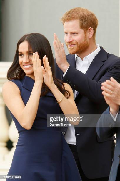 Prince Harry Duke of Sussex and Meghan Duchess of Sussex applaud the activities at Government House on October 18 2018 in Melbourne Australia The...