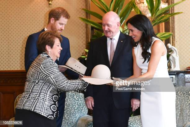 Prince Harry Duke of Sussex and Meghan Duchess of Sussex are given gifts from Australia's Governor General Peter Cosgrove and wife Lynne Cosgrove at...