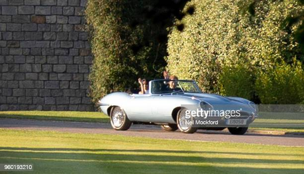 Prince Harry, Duke of Sussex and Meghan, Duchess of Sussex are seen leaving Windsor Castle following their wedding on May 19, 2018 in Windsor,...