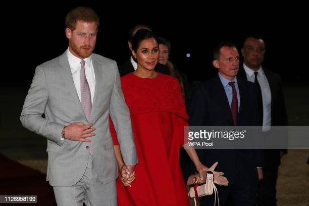 Prince Harry Duke of Sussex and Meghan Duchess of Sussex are welcomed by British Ambassador to Morocco Thomas Reilly as they arrive at Casablanca...
