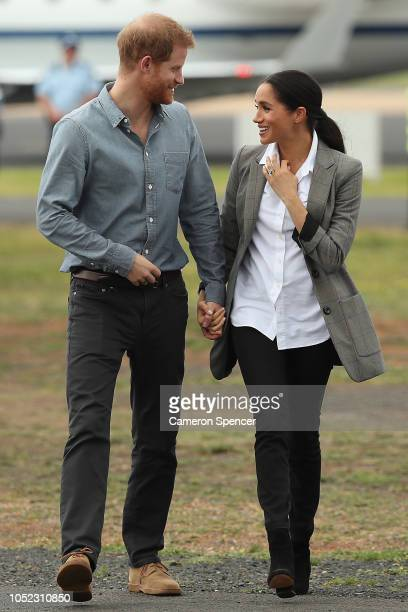 Prince Harry Duke of Sussex and Meghan Duchess of Sussex arrive at Dubbo Airport on October 17 2018 in Dubbo Australia The Duke and Duchess of Sussex...