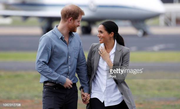 Prince Harry, Duke of Sussex and Meghan, Duchess of Sussex arrive at Dubbo Airport on October 17, 2018 in Dubbo, Australia. The Duke and Duchess of...