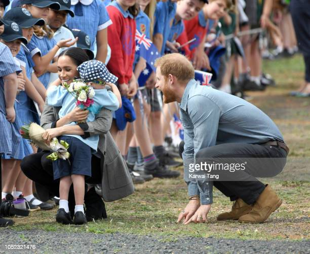 Prince Harry Duke of Sussex and Meghan Duchess of Sussex arrive at Dubbo airport and is greeted by 5 year old Luke Vincent on October 17 2018 in...