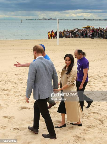 Prince Harry Duke of Sussex and Meghan Duchess of Sussex arrive at South Melbourne Beach on October 18 2018 in Melbourne Australia BeachPatrol is a...