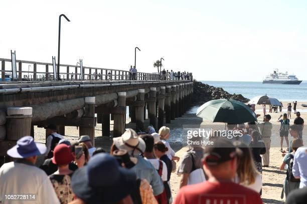 Prince Harry Duke of Sussex and Meghan Duchess of Sussex arrive at Kingfisher bay walk about on October 22 2018 in Fraser Island Australia The Duke...