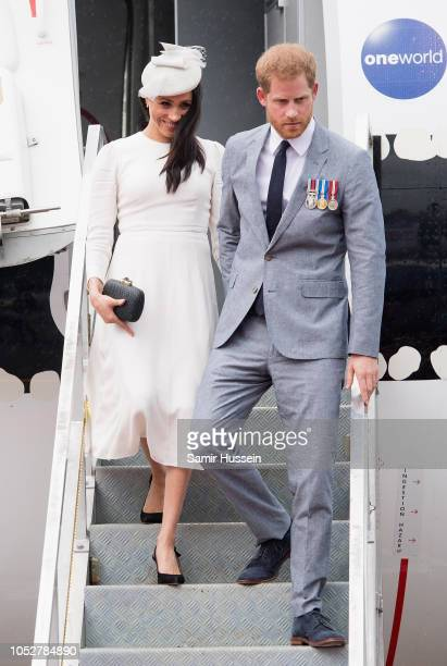 Prince Harry Duke of Sussex and Meghan Duchess of Sussex arrive at Nausori Airport on October 23 2018 in Suva Fiji The Duke and Duchess of Sussex are...
