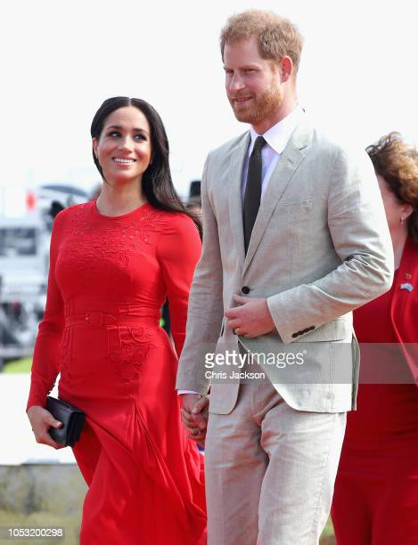 Prince Harry, Duke of Sussex and Meghan, Duchess of Sussex arrive at Fua'amotu Airport on October 25, 2018 in Nuku'alofa, Tonga. The Duke and Duchess...