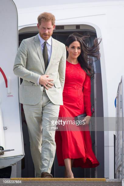 Prince Harry Duke of Sussex and Meghan Duchess of Sussex arrive at Fua'amotu Airport on October 25 2018 in Nuku'Alofa Tonga The Duke and Duchess of...
