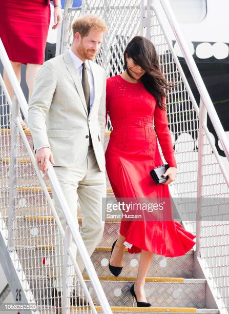 Prince Harry, Duke of Sussex and Meghan, Duchess of Sussex arrive at Nuku'alofa airport on October 25, 2018 in Nuku'alofa, Tonga. The Duke and...
