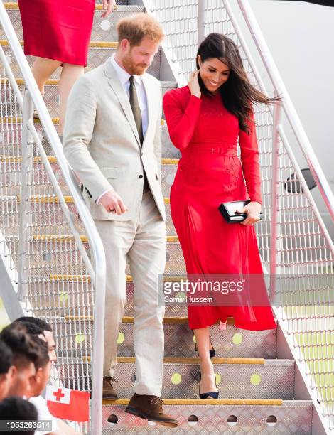 Prince Harry Duke of Sussex and Meghan Duchess of Sussex arrive at Nuku'alofa airport on October 25 2018 in Nuku'alofa Tonga The Duke and Duchess of...