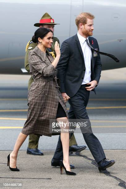 Prince Harry Duke of Sussex and Meghan Duchess of Sussex arrive at the Wellington International Airport Military Terminal on October 28 2018 in...