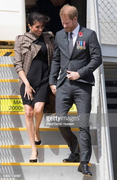 Prince Harry Duke of Sussex and Meghan Duchess of Sussex arrive at Wellington airport on October 28 2018 in Wellington New Zealand The Duke and...