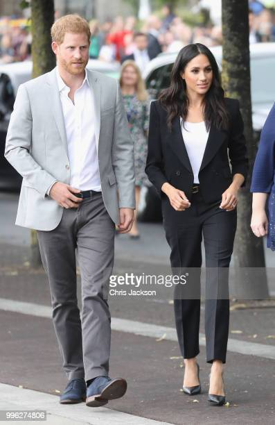Prince Harry Duke of Sussex and Meghan Duchess of Sussex arrive at the Famine Memorial on the bank of the River Liffey during their visit to Ireland...