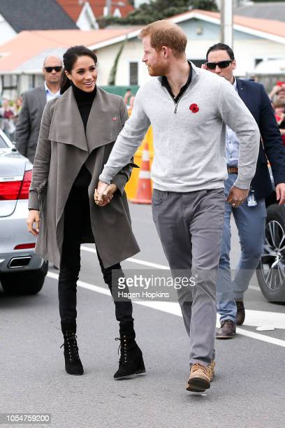Prince Harry Duke of Sussex and Meghan Duchess of Sussex arrive for a meeting with young people in the Mental Health Sector at Maranui Cafe on...