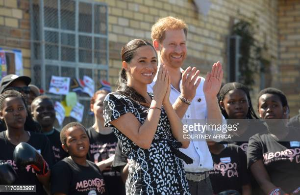 """Prince Harry, Duke of Sussex and Meghan, Duchess of Sussex arrive for a visit to the """"Justice desk"""", an NGO in the township of Nyanga in Cape Town,..."""