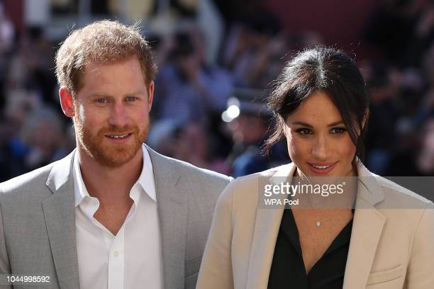 Prince Harry, Duke of Sussex and Meghan, Duchess of Sussex arrive for an engagement at Edes House during an official visit to Sussex on October 3,...