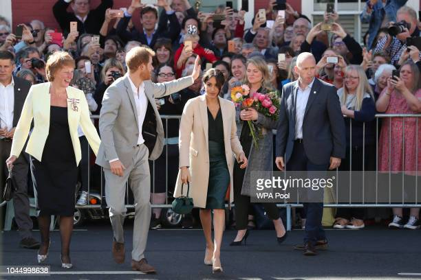 Prince Harry Duke of Sussex and Meghan Duchess of Sussex arrive for an engagement at Edes House during an official visit to Sussex on October 3 2018...