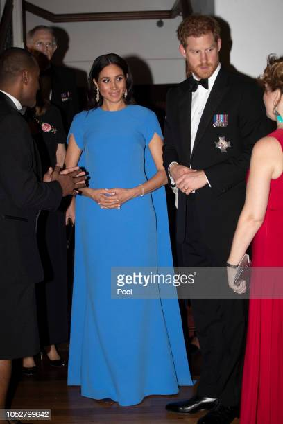 Prince Harry Duke of Sussex and Meghan Duchess of Sussex arrive for the State dinner on October 23 2018 in Suva Fiji The Duke and Duchess of Sussex...