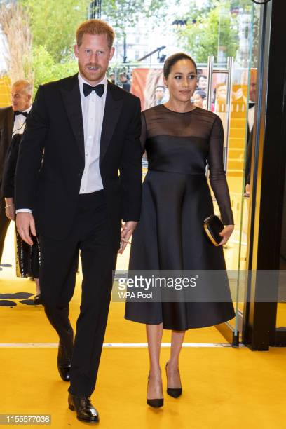 "Prince Harry, Duke of Sussex and Meghan, Duchess of Sussex arrive to attend the European Premiere of Disney's ""The Lion King"" at Odeon Luxe Leicester..."