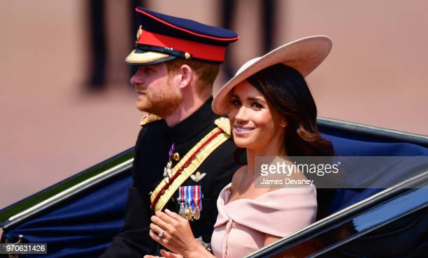 Prince Harry Duke of Sussex and Meghan Duchess of Sussex arrive to Buckingham Palace in a carriage during the Trooping the Colour parade on June 9...