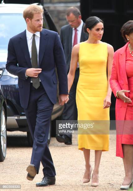 Prince Harry Duke of Sussex and Meghan Duchess of Sussex arrive to attend the Your Commonwealth Youth Challenge reception at Marlborough House on...
