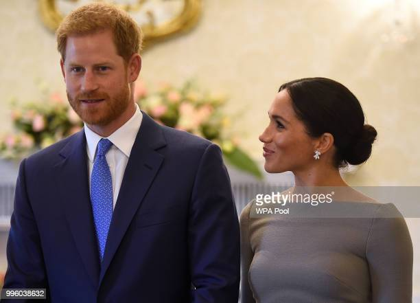 Prince Harry Duke of Sussex and Meghan Duchess of Sussex arrive to meet Ireland's President Michael Higgins at Aras an Uachtarain during day two of...
