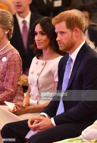 Prince Harry Duke of Sussex and Meghan Duchess of Sussex at the Queen's Young Leaders Awards Ceremony at Buckingham Palace London