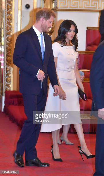 Prince Harry Duke of Sussex and Meghan Duchess of Sussex at the Queen's Young Leaders Awards Ceremony at Buckingham Palace on June 26 2018 in London...