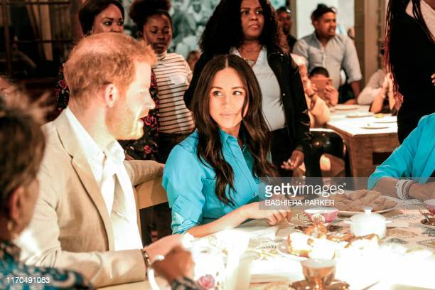 Prince Harry Duke of Sussex and Meghan Duchess of Sussex attend a dinner at the District Six Homecoming Centre in Cape Town as part of their tour of...