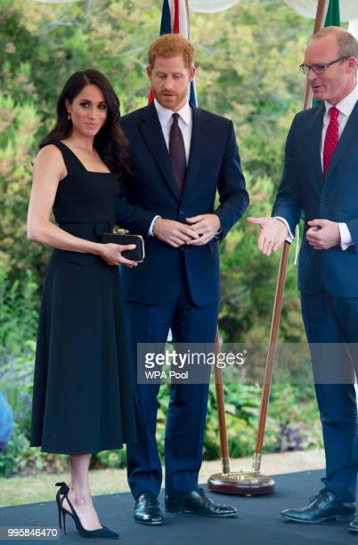Prince Harry Duke of Sussex and Meghan Duchess of Sussex attend a reception at Glencairn the residence of Robin Barnett the British Ambassador to...