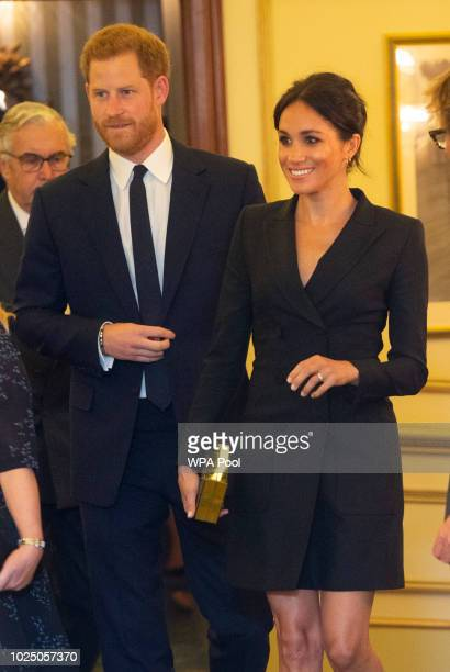 "Prince Harry, Duke of Sussex and Meghan, Duchess of Sussex attend a gala performance of ""Hamilton"" in support of Sentebale at Victoria Palace Theatre..."