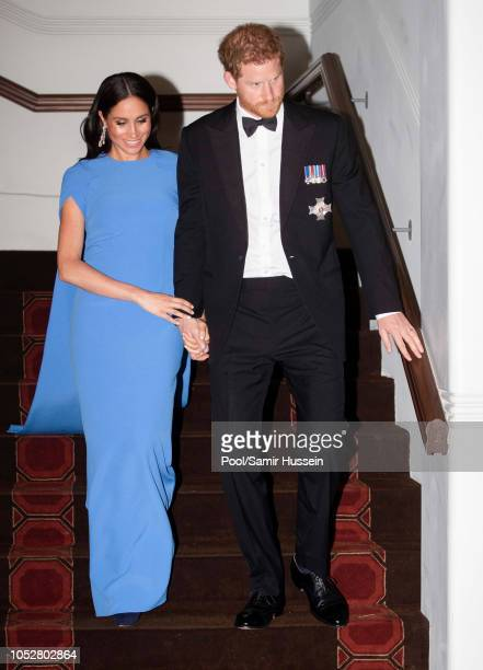 Prince Harry Duke of Sussex and Meghan Duchess of Sussex attend a state dinner hosted by the president of the South Pacific nation Jioji Konrote at...