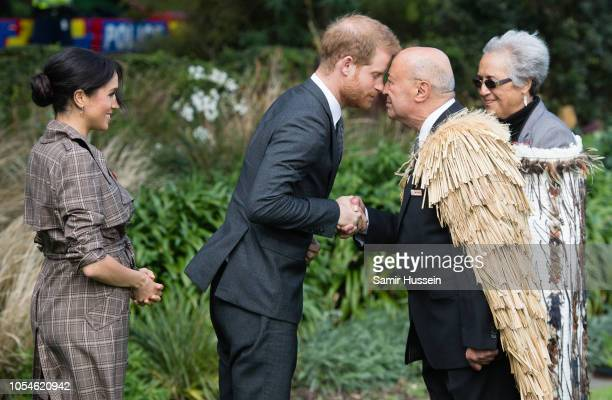 Prince Harry Duke of Sussex and Meghan Duchess of Sussex attend a traditional welcome ceremony on the lawns of Goverment House on October 28 2018 in...