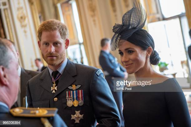 Prince Harry Duke of Sussex and Meghan Duchess of Sussex attend a reception to mark the centenary of the Royal Air Force at Buckingham Palace on July...