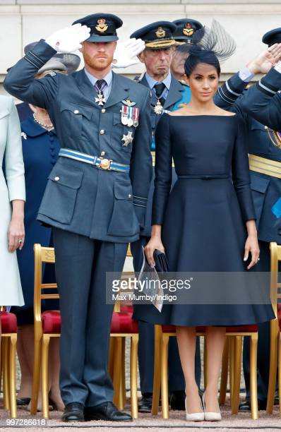 Prince Harry Duke of Sussex and Meghan Duchess of Sussex attend a ceremony to mark the centenary of the Royal Air Force on the forecourt of...